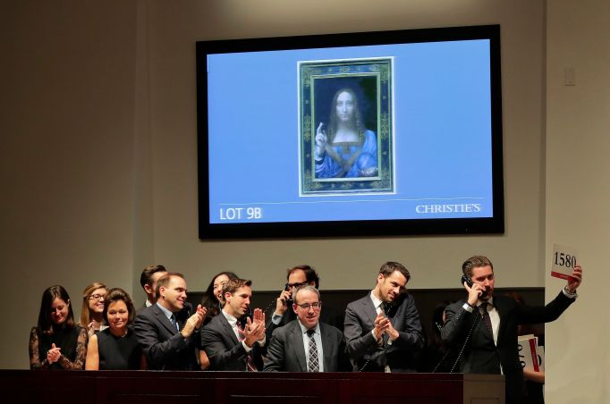 Bidding representatives react after Leonardo da