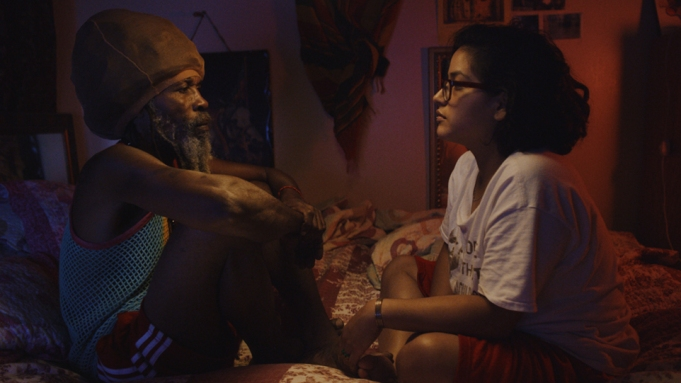An older Rastafarian man and a