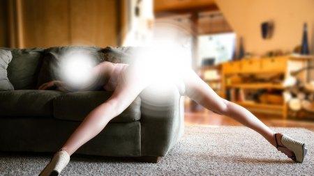 A photograph of a woman bending