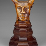 'Head With Horns,' ca. 1894, sandalwood with traces of polychromy on a lacewood base