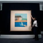 A Sotheby's employee adjusts a painting by British artist David Hockney, titled 'The Splash,' at a press preview of Sotheby's Contemporary Art sale in London, Britain, 07 February 2020. The artwork is estimated to fetch 20-30 million GPB (about 23-35 million EUR) at auction on 11 February 2020.Press Preview of Sotheby's Contemporary Art Evening Auction, London, United Kingdom - 07 Feb 2020