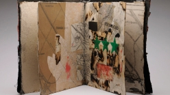 A collaged book, shown open, by Hanna Mallal, and titled Baghdad City: US Map.