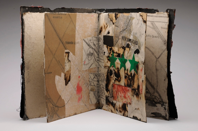 A collaged book, shown open, by