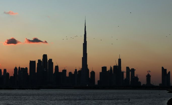 The sun sets behind the skyline