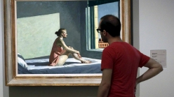 A museum visitor looking at Edward Hopper's 'Morning Sun' (1952).
