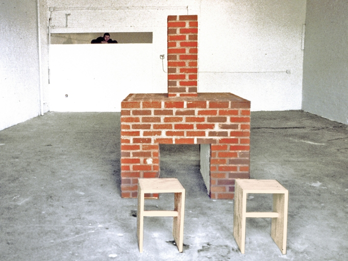 Installation with an empty free-standing brick