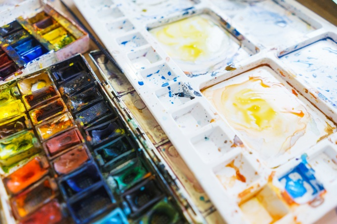 Palette with watercolors in different colors.