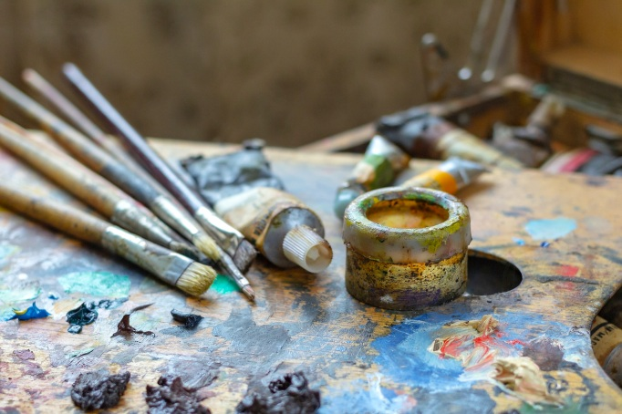 Artist's palette with oil paints, brushes,