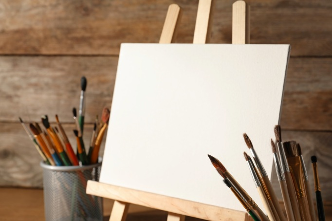 Easel with blank canvas board