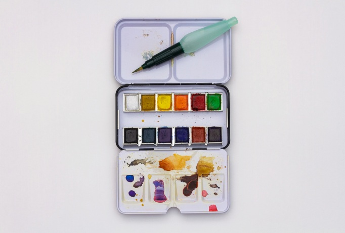 Opened metal box with multi-colored watercolor