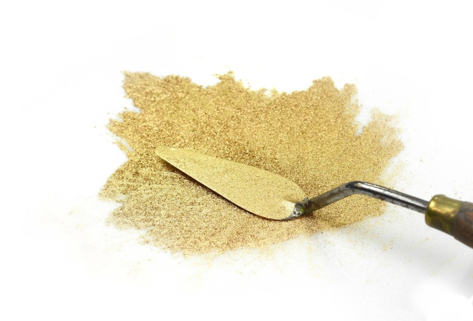 gold glitter powder on white background