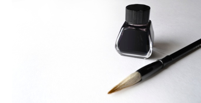 Ink bottle with brush for painting