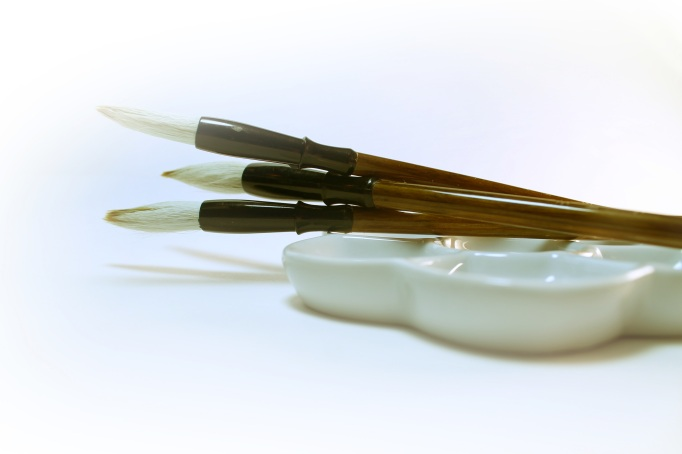 Three white chinese brushes for calligraphy