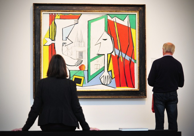 Visitors Look at the Painting 'The