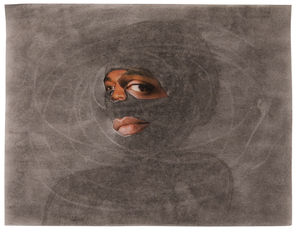 a black persons eyes and mouth cut out from a photographed collaged onto a gray graphite-covered sheet of paper