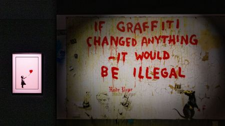 Artworks by Banksy in an exhibition