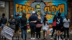 Cadex Herrera, Greta McLain, and Xena Goldman's mural in Minneapolis paying homage to George Floyd has become an iconic image for many protesters.