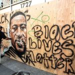 A mural devoted to George Floyd in Oakland, California.