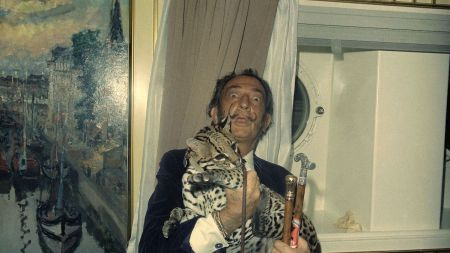 Salvador Dali with his ocelot Babou.