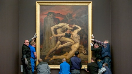 An art handler looks at the
