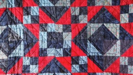 Blue and Red Patchwork Quilt