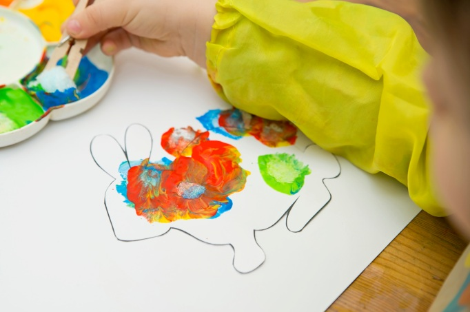 child with painting.