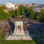 protesters gather around the statue of Confederate General Robert E. Lee in Richmond, Va.