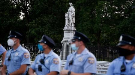 Philadelphia police officers gather near the