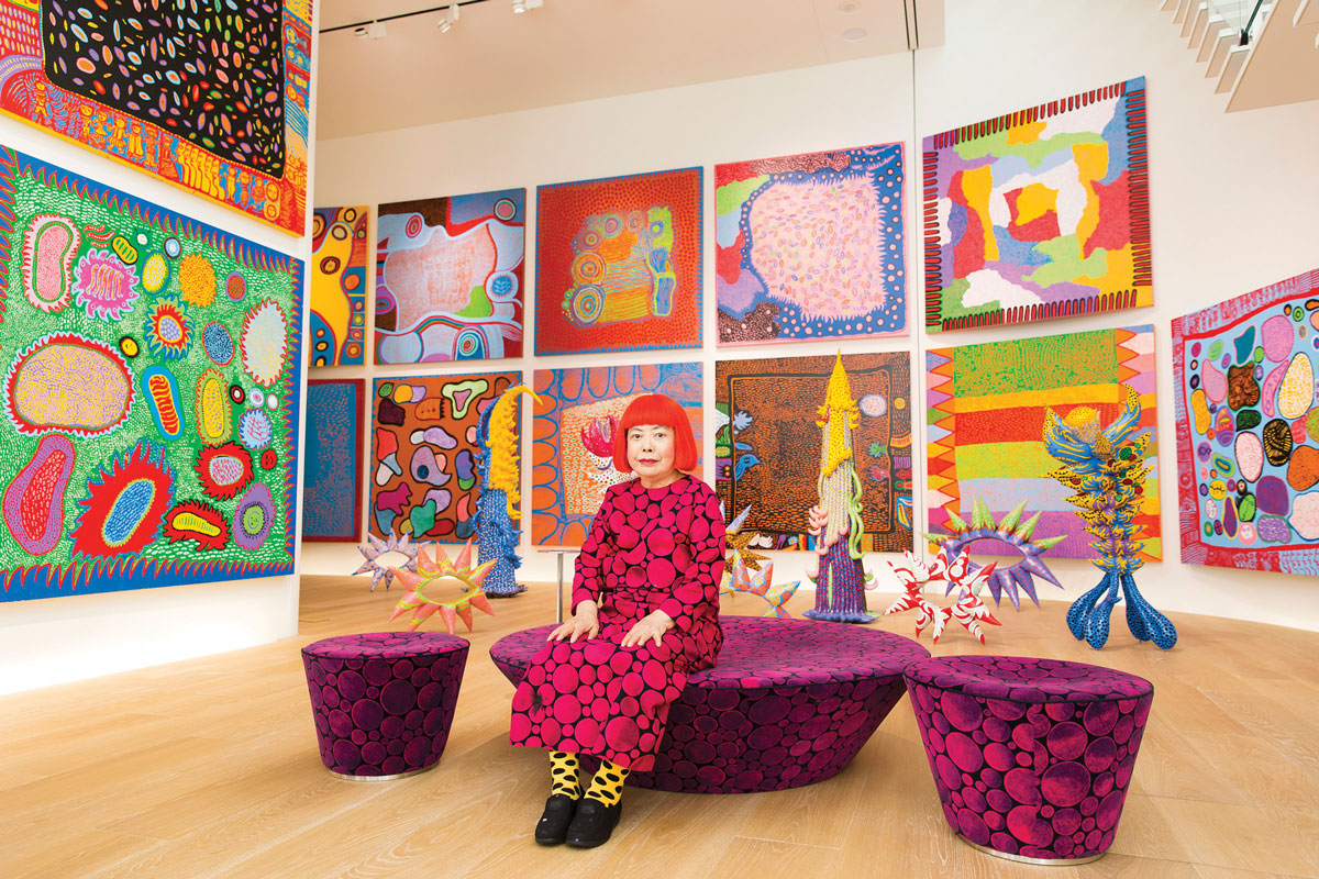 Yayoi Kusama with paintings from her ongoing series 'My Eternal Soul.'