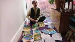 Marcel Dzama in his home with some of his new drawings based on a family trip to Mexico.