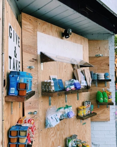 ALT space's pop-up market is situated in a vacant storefront and features various goods on wooden shelves.