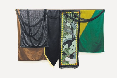 hanging green, yellow, and black fabric piece