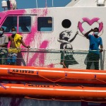 Refugees aboard the Banksy-funded Louise Michel