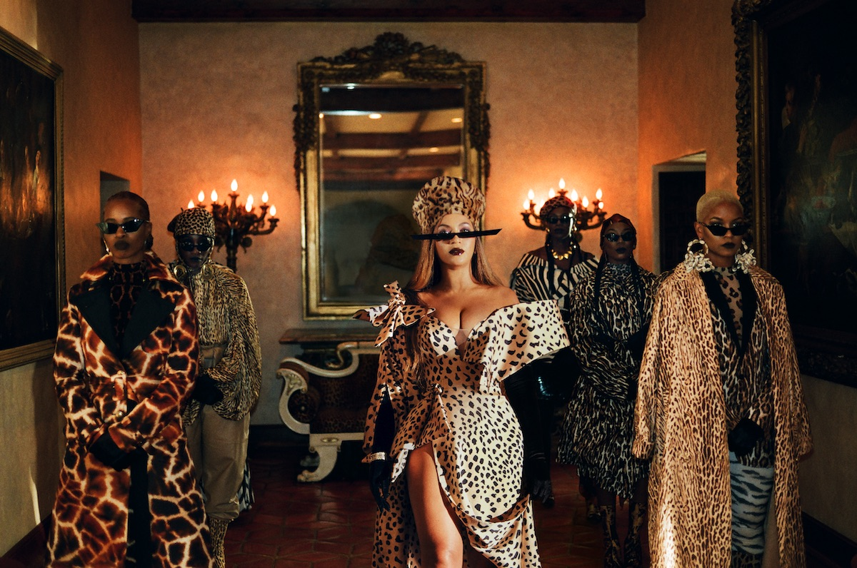 Beyoncé in 'Mood 4 Eva' wearing thin sunglasses and flanked by dancers.