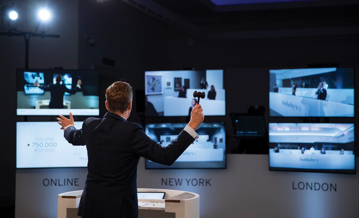A Sotheby's auctioneer, based in London, taking virtual bids from specialists in London, New York, and Hong Kong, during an evening sale on June 29.