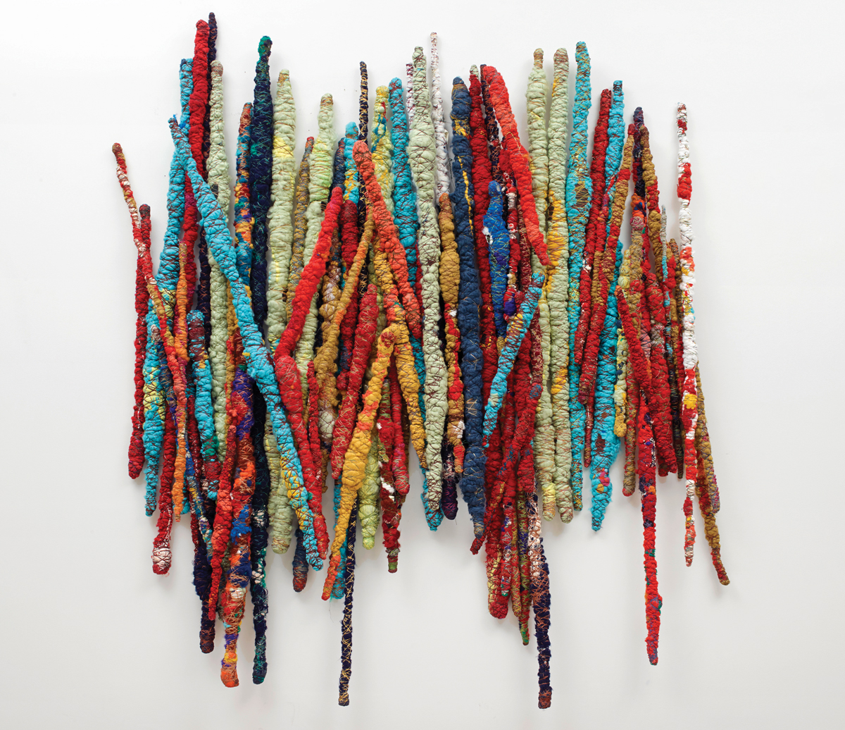 Sheila Hicks, Safe Passage, 2014-15. A fabric artwork with various multicolored sticks arranged together.