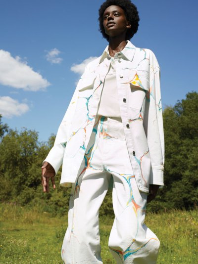 McCartney look: Y for Youth. An all white assemble with splashes of color on the garment.
