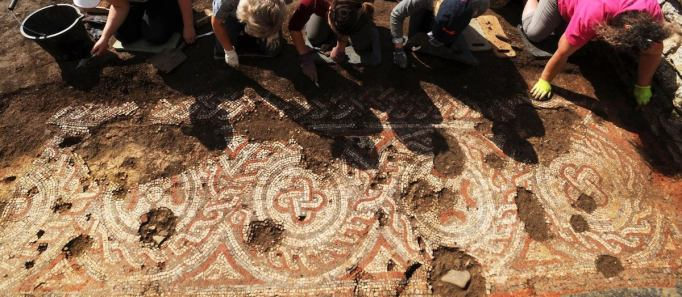 British archaeologists unearthing a mosaic in