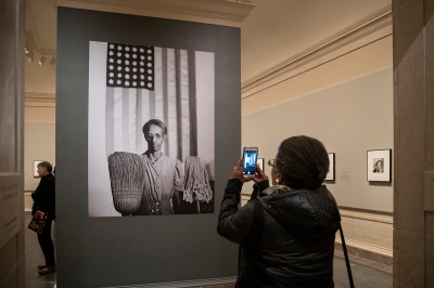 View of former Farm Security Administration cleaner Ella Watson taking a picture of Gordon Parks's 1942 photograph American Gothic.