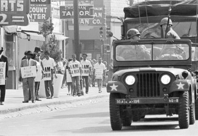 View of the Tennessee National Guard escorting Memphis Sanitation Workers' protestors, 1968, in downtown Memphis, Tennessee.
