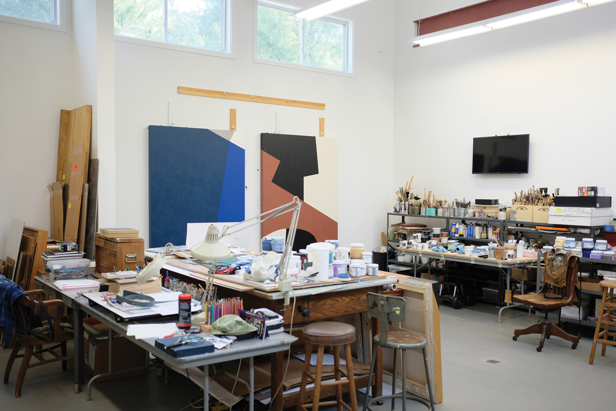 Jaramillo's studio in Hampton Bays, New York, which is attached to her home, includes two workstations, filled with art supplies.