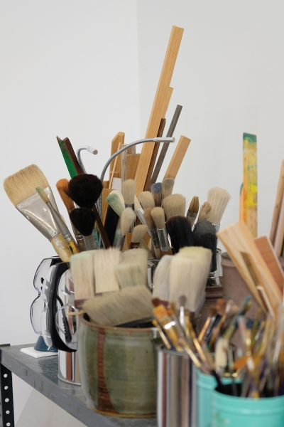 In Virginia Jaramillo's studio are a line of dozens of paint brushes of varying sizes.