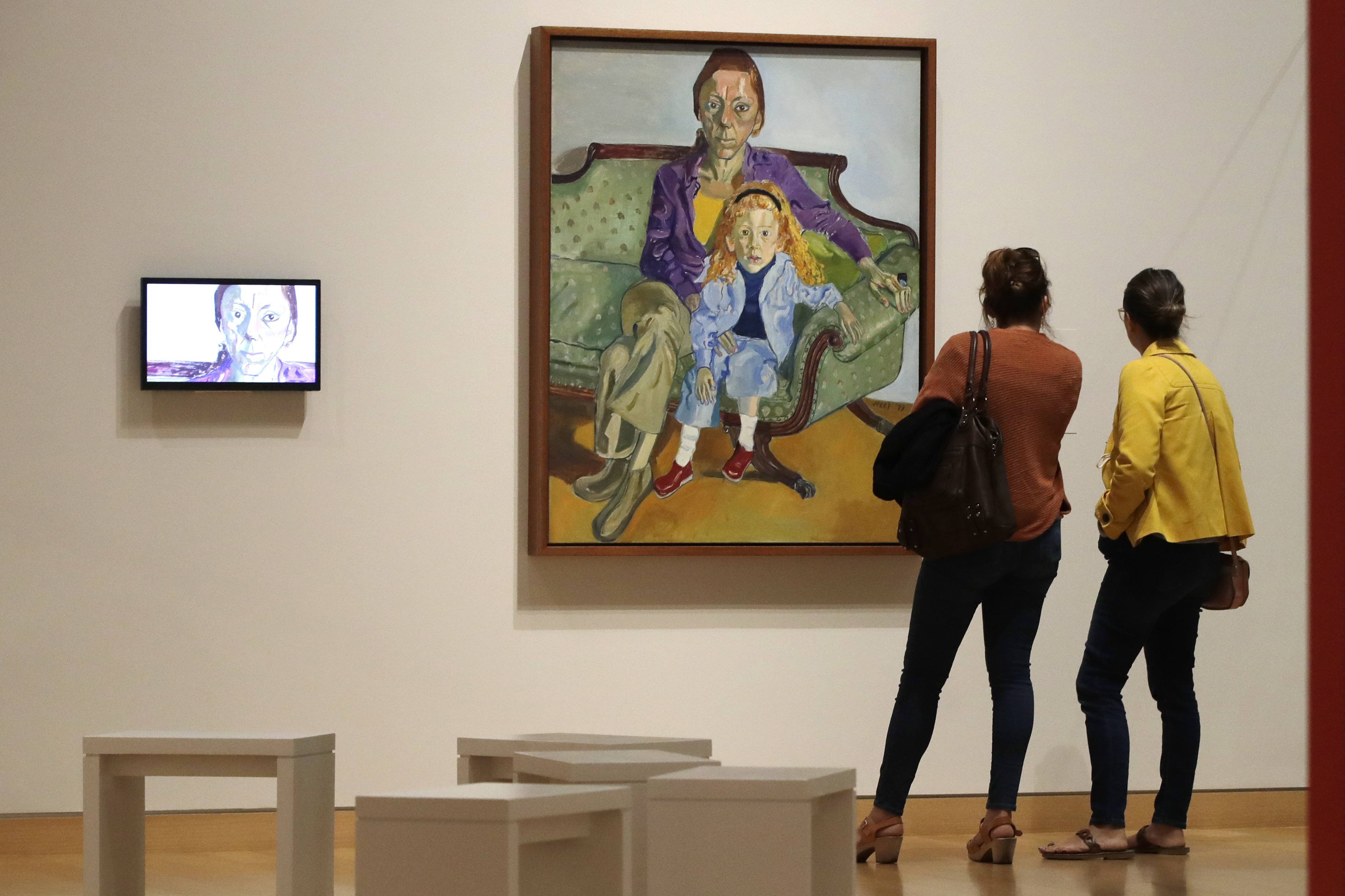 "In this Sept. 18, 2019, photo, two women look at a painting by American artist Alice Neel at the exhibit ""Women Take the Floor"" at the Museum of Fine Arts in Boston. In the wake of a student group incident last spring when the world-class museum was accused of racism, the MFA has scrambled to make amends. In a nod to the need for greater gender equity, it has given over an entire wing to female artists in ""Women Take the Floor,"" an exhibition timed to coincide with next year's centennial of U.S. women winning the right to vote. (AP Photo/Elise Amendola)"