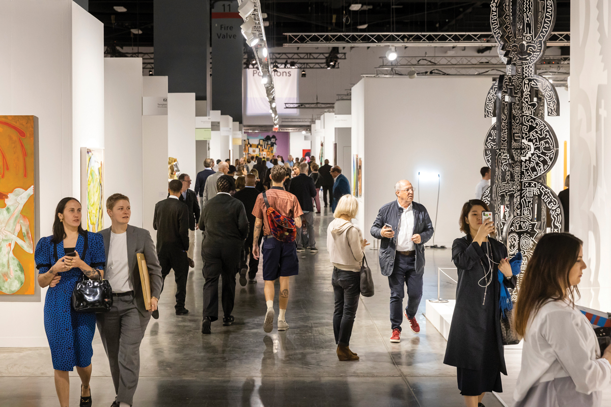 Attendees stroll the aisles at Art Basel Miami Beach in 2019. A tax on sales at the fair could lead to welcome change for the future.