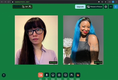 Portraits of two women, one with long black hair and glasses adn the other with bright blue hair, sit side by side on a green web page
