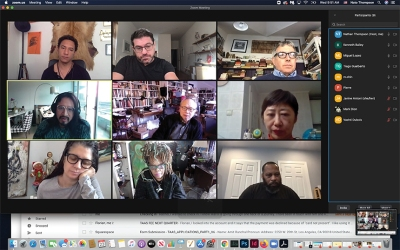 A screenshot of a video chat, with feeds of nine people at home arranged in a grid