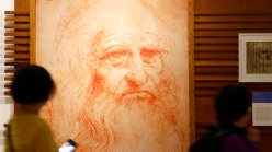 Visitors look at a portrait drawing of Italian Renaissance painter, scientist and inventor Leonardo Da Vinci during a permanent exhibition on Da Vinci, on the exact day commemorating the 500th anniversary of his death, in Rome, Thursday, May 2, 2019. Leonardo died in Amboise, France, on May 2, 1519.  (AP Photo/Alessandra Tarantino)