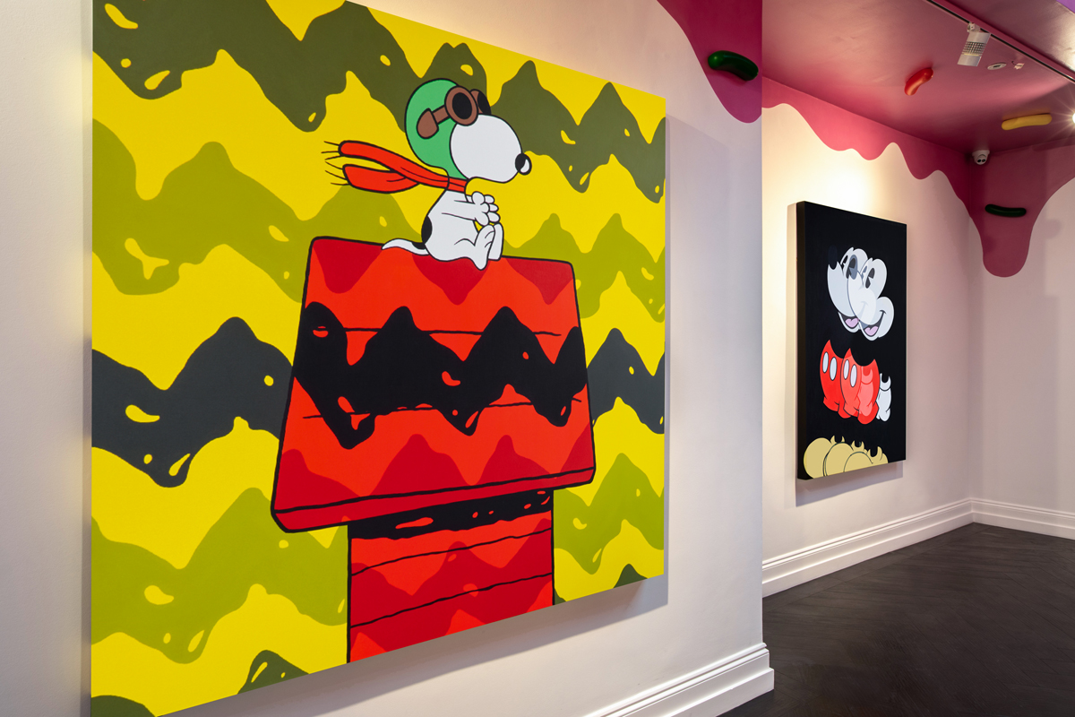 Installation view of Jerkface's work at Maddox Gallery. At left, an image of Snoopy on his house as Flying Ace; at right, a double Mickey Mouse.