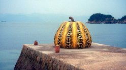 """Undated file photo shows renowned avant-garde artist Yayoi Kusama's artwork called """"Pumpkin"""" in Naoshima, Kagawa Prefecture, western Japan. The work was damaged after it was blown by high winds in a typhoon and dropped into the sea before being retrieved on Aug. 9, 2021, according to its owner Benesse Holdings Inc. (Kyodo via AP Images) ==Kyodo"""