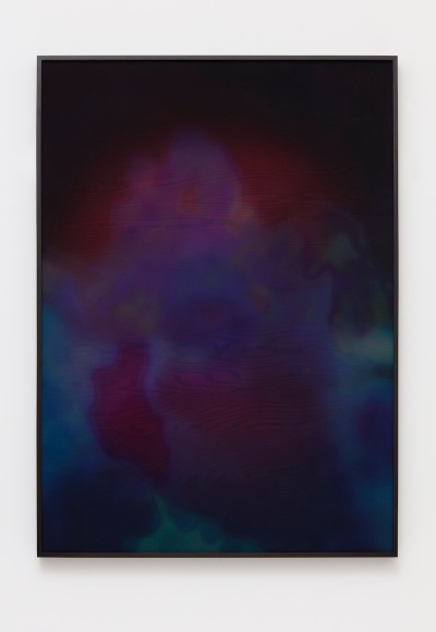 A vertical textile work is dominated by deep violet and blue hues, in an abstract image suggestive of clouds.